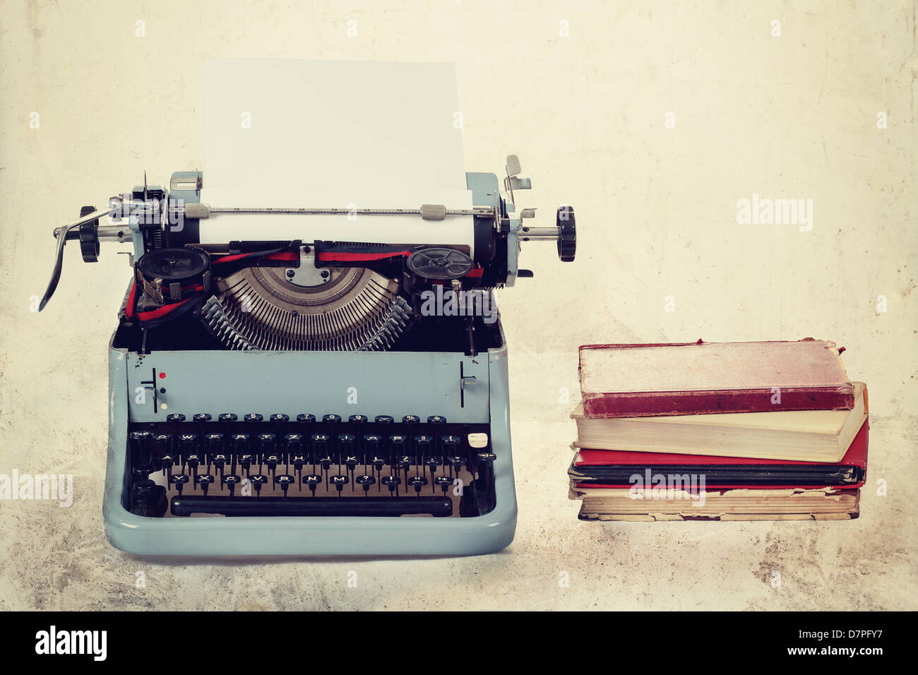 Old typewriter with paper and books, retro colors on the desk Stock ...