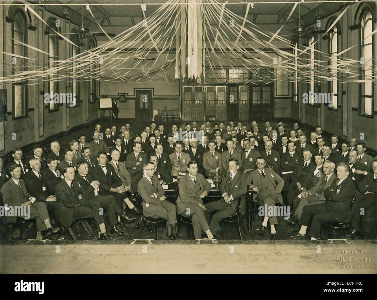 Large group of men at meeting, 1920 - 1929 - Stock Image
