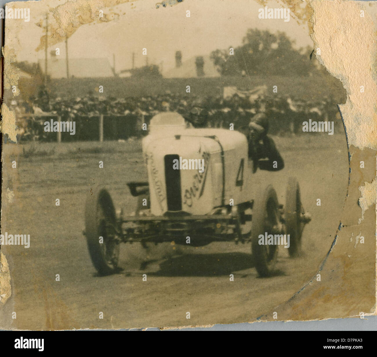 Don Harkness at the wheel of his Overland Sports car 'Whitey' at race meeting - Stock Image