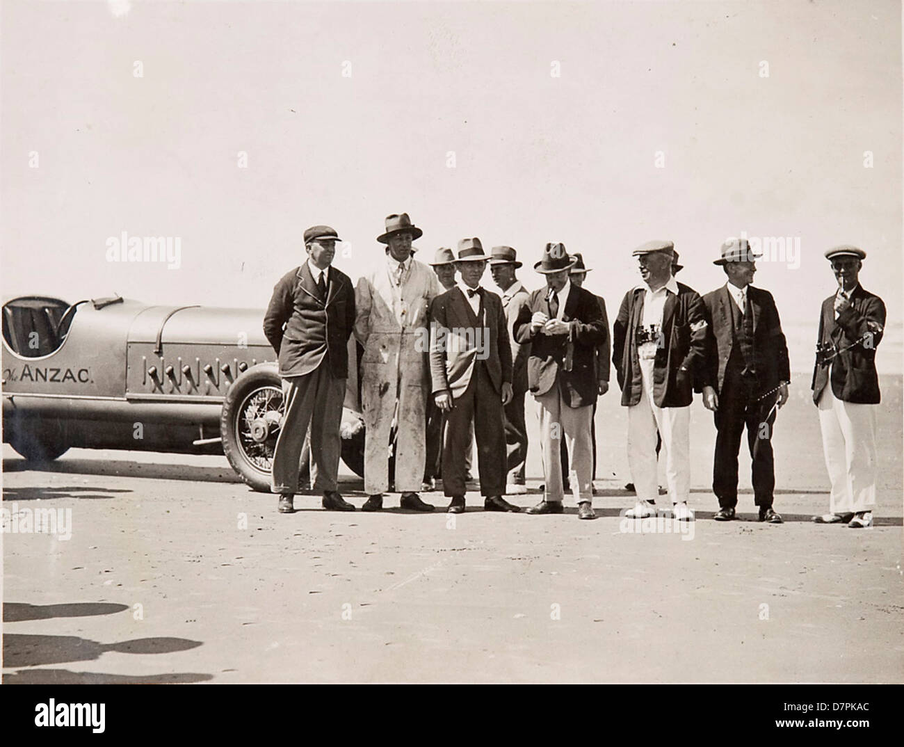 Men on beach with 'Anzac' car - Stock Image