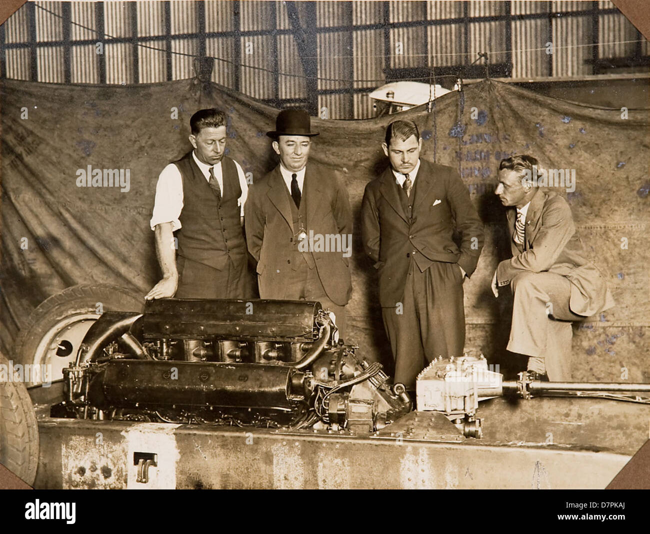 Group inspecting the car 'F.H. Stewart Enterprise' - Stock Image