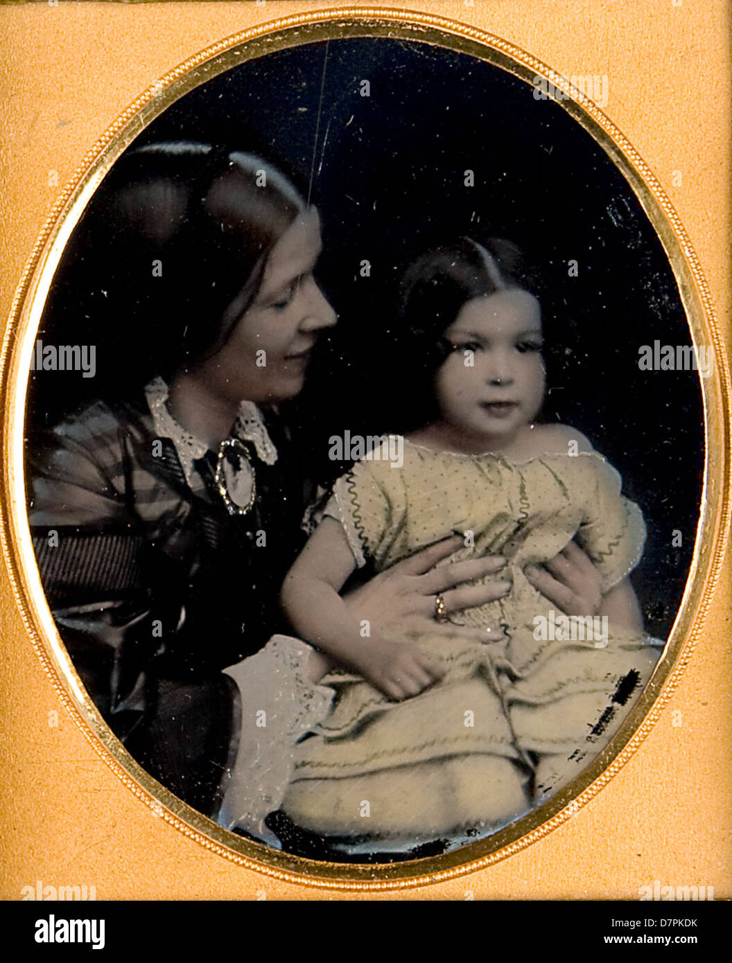 Unidentified young girl and mother - Stock Image