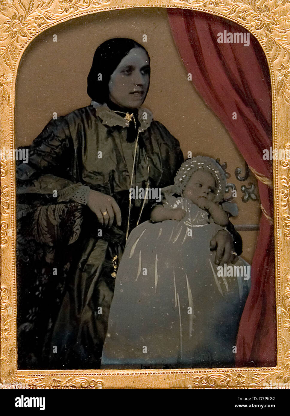 Unidentified woman and baby - Stock Image