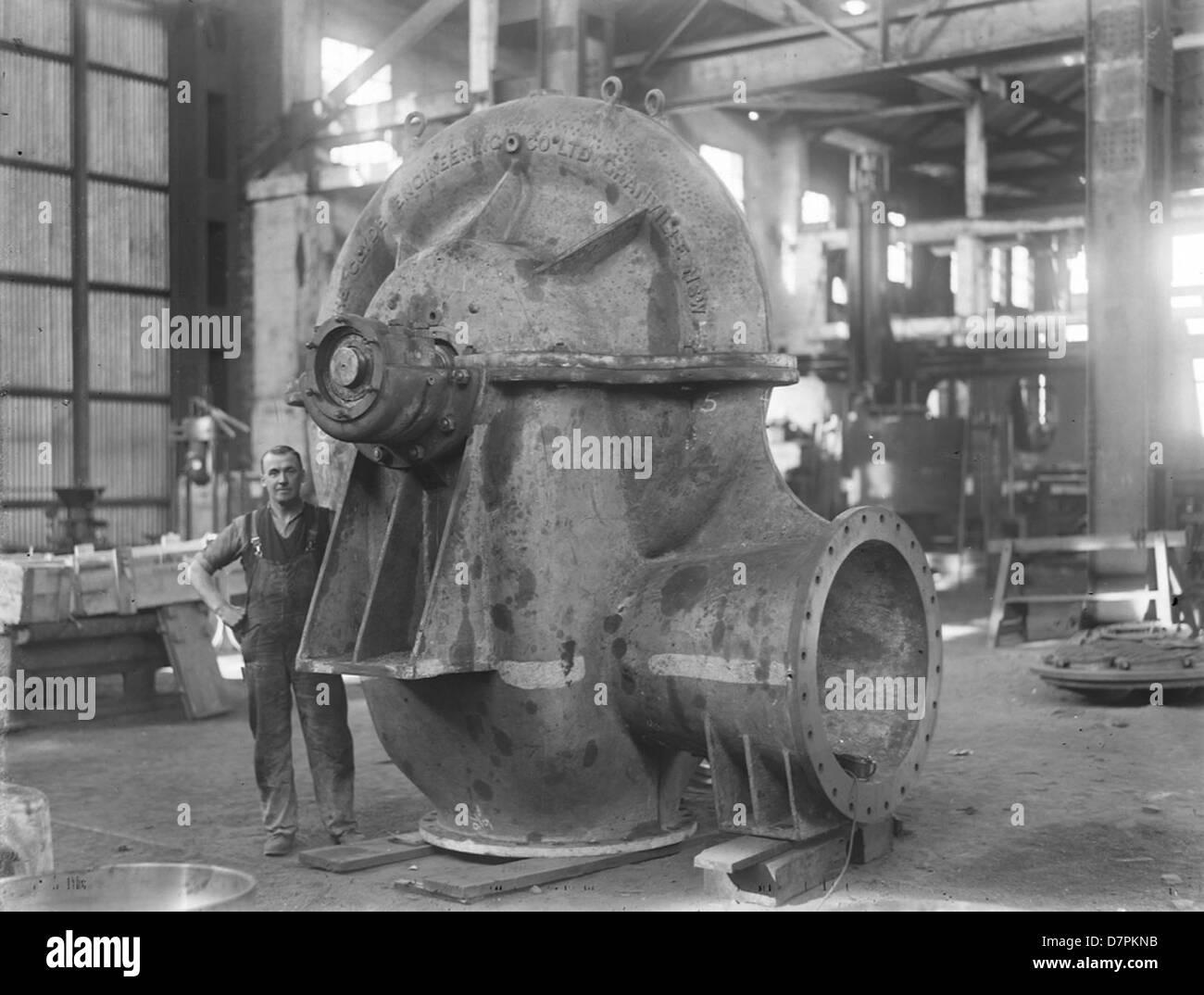 Workmen and split case centrifugal pump - Stock Image