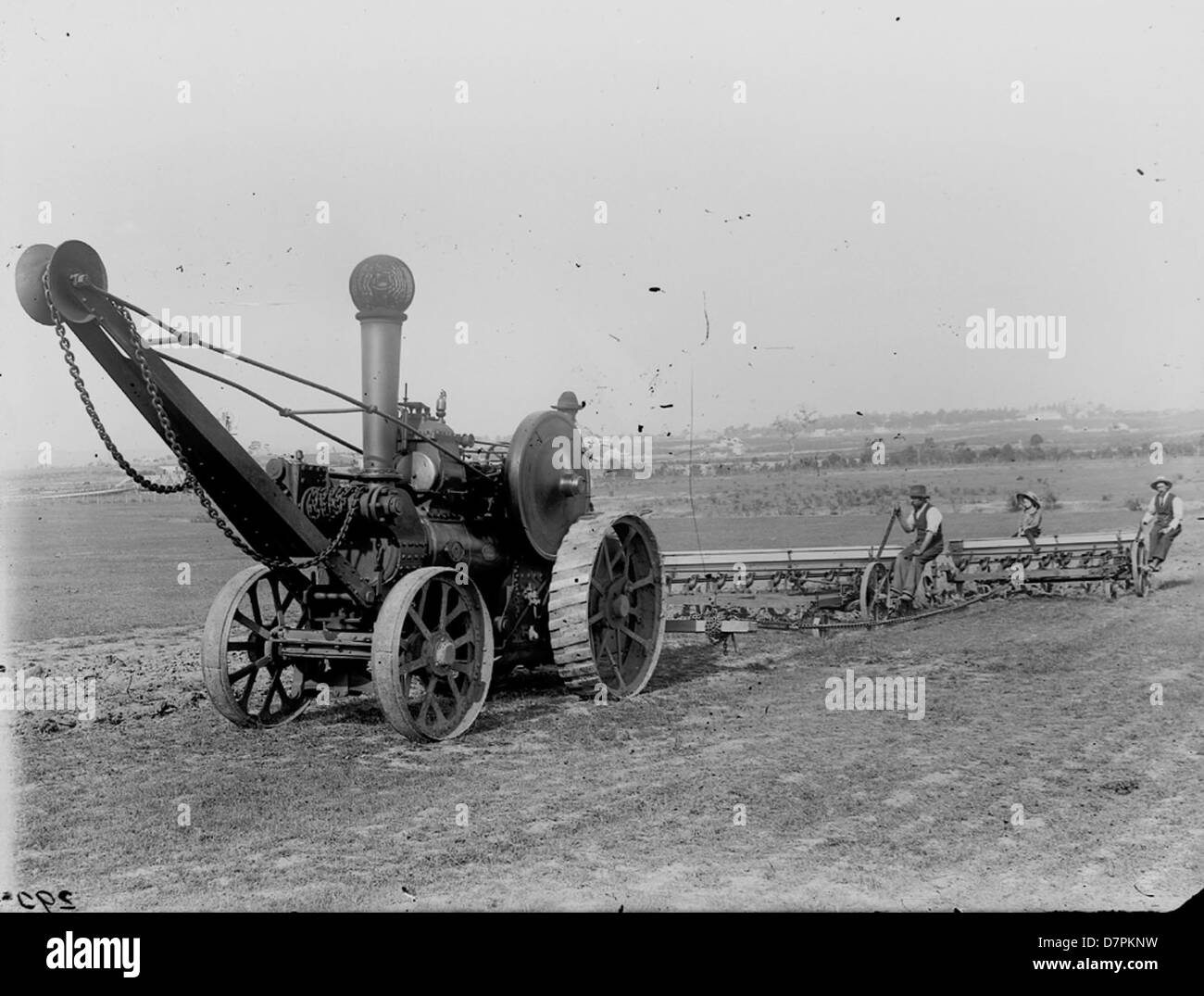 Workers operating seed drills and Fowler traction - Stock Image