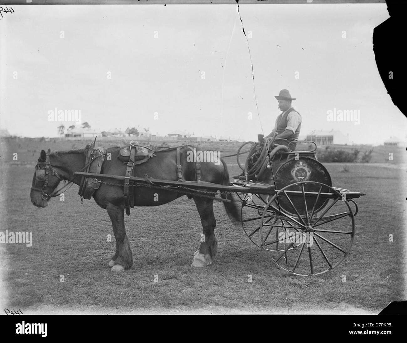 Clyde horsedrawn fire fighting cart with driver - Stock Image