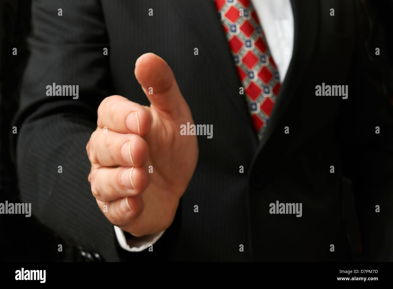 closeup of businessman's hand outstretched for a handshake Stock Photo