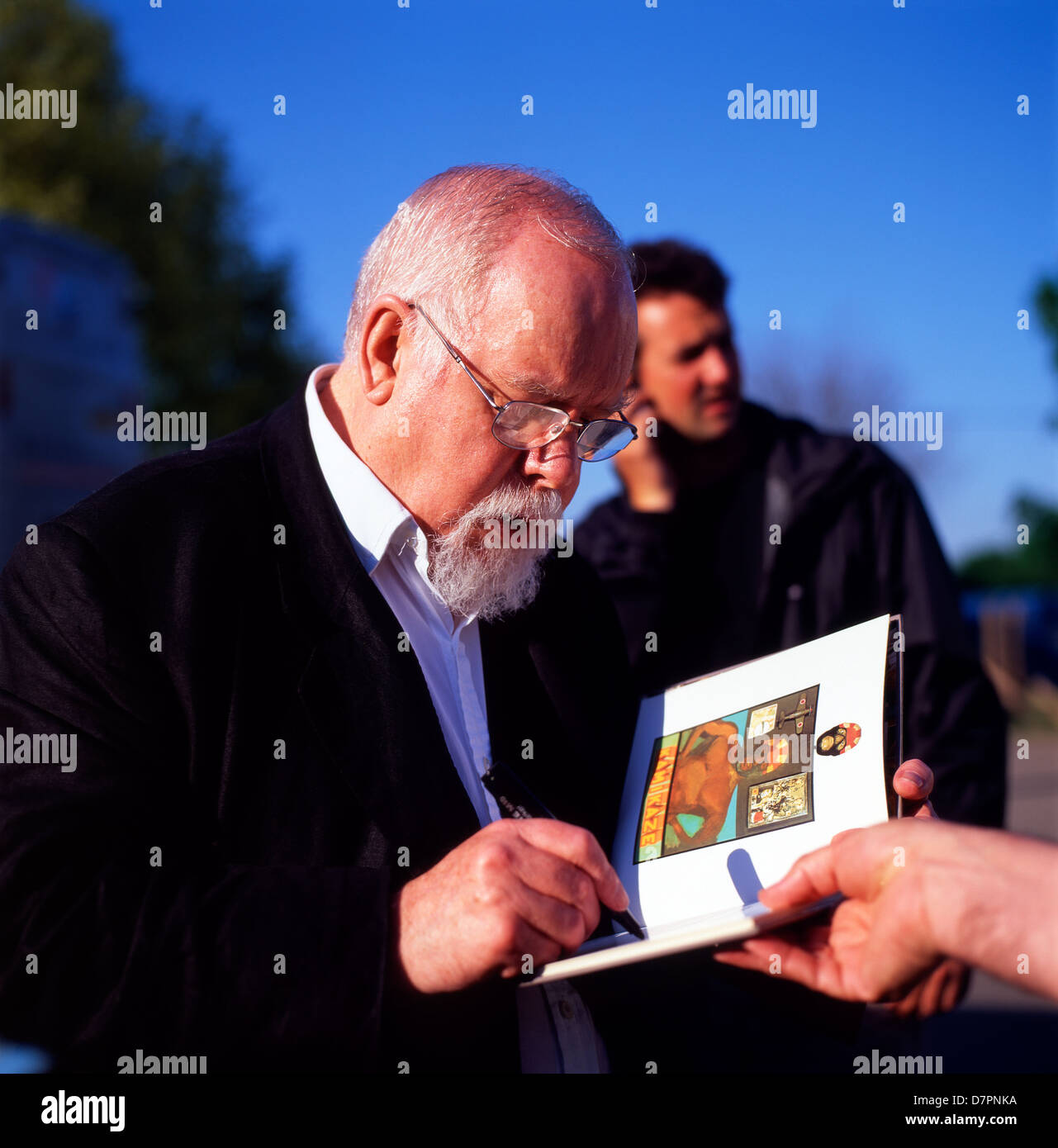 British pop artist Peter Blake signing a book at the Hay Festival, Hay-on-Wye Wales UK KATHY DEWITT Stock Photo
