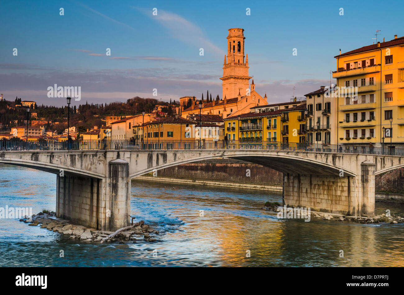 Bridge over Adige river in Verona with Duomo tower in background, Italy historic city. - Stock Image
