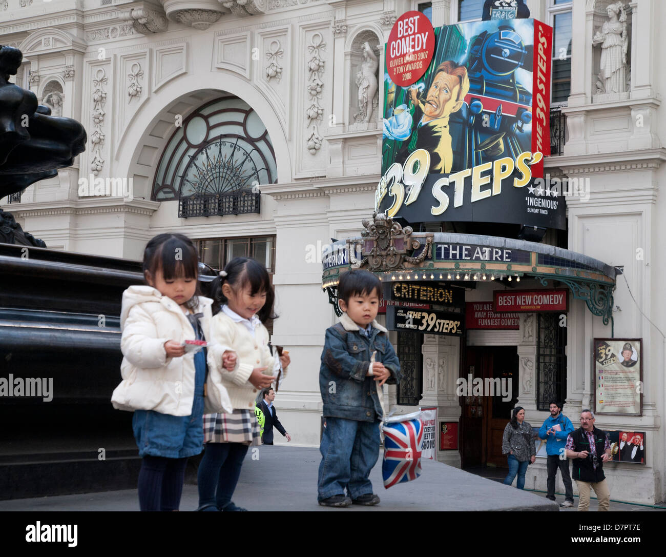 Asiatic children outside the Criterion Theatre, West End, London, England, United Kingdom - Stock Image