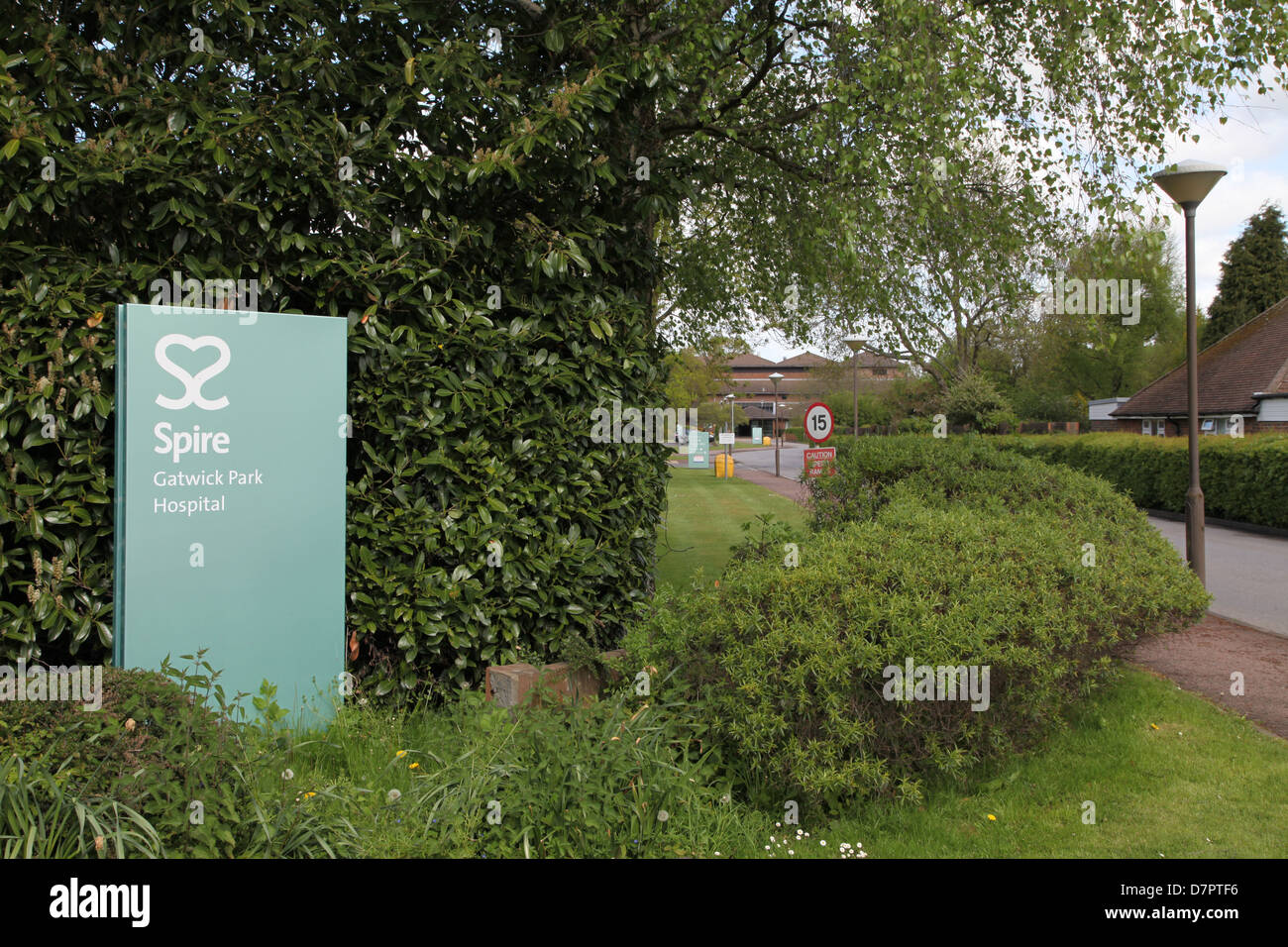 Sign at the entrance to Spire Healthcare Hospital Povey Cross Road Horley Surrey - Stock Image