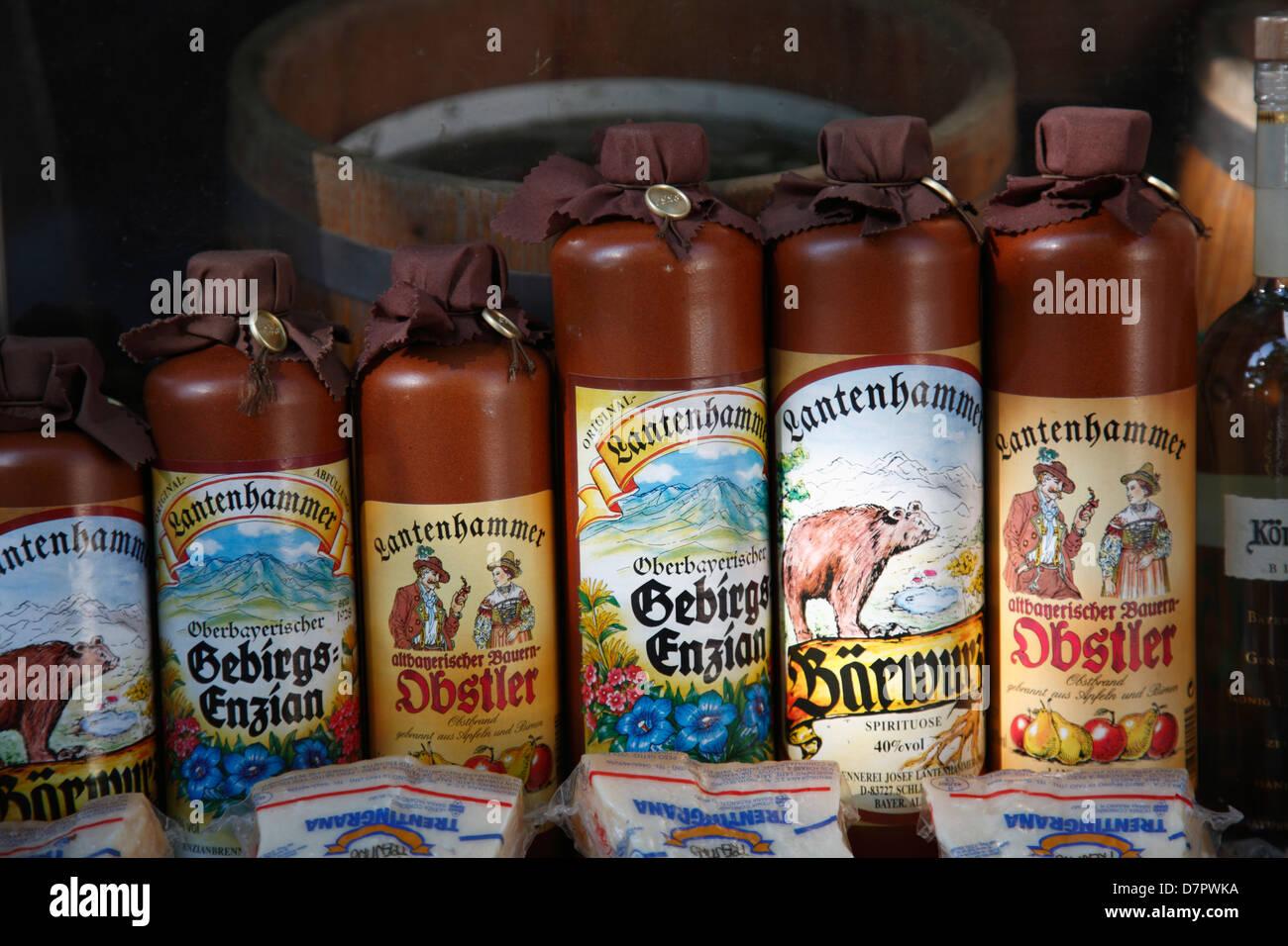 Traditional bavarian alkohol at Viktualienmarkt, market stall, Munich, Bavaria, Germany - Stock Image