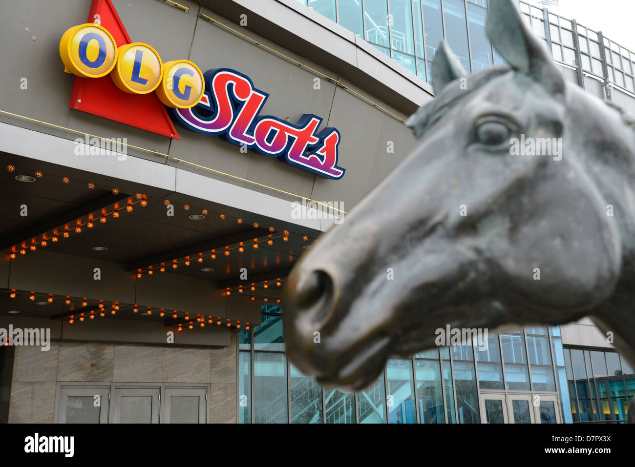 Ontario Lottery and Gaming sign for slots with sculpture of Northern Dancer at Woodbine Racetrack in Toronto - Stock Image