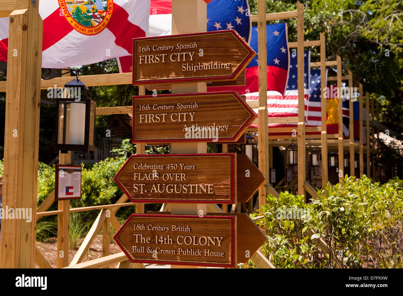 A row of flags showing every ones that once flew over the city is seen in the Colonial Quarter, St. Augustine, Florida - Stock Image