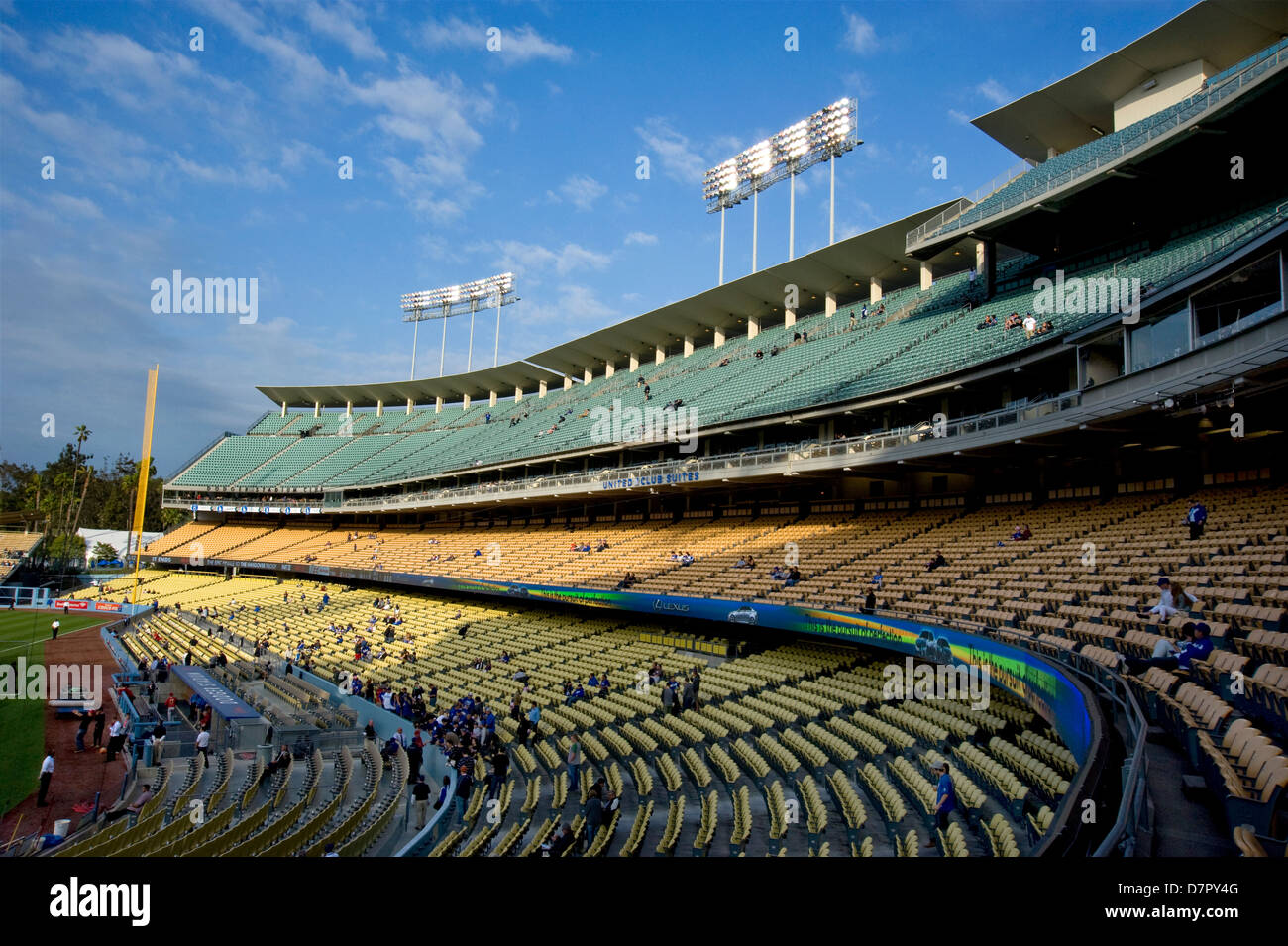Fans arriving at Dodger Stadium in late afternoon for a night game - Stock Image