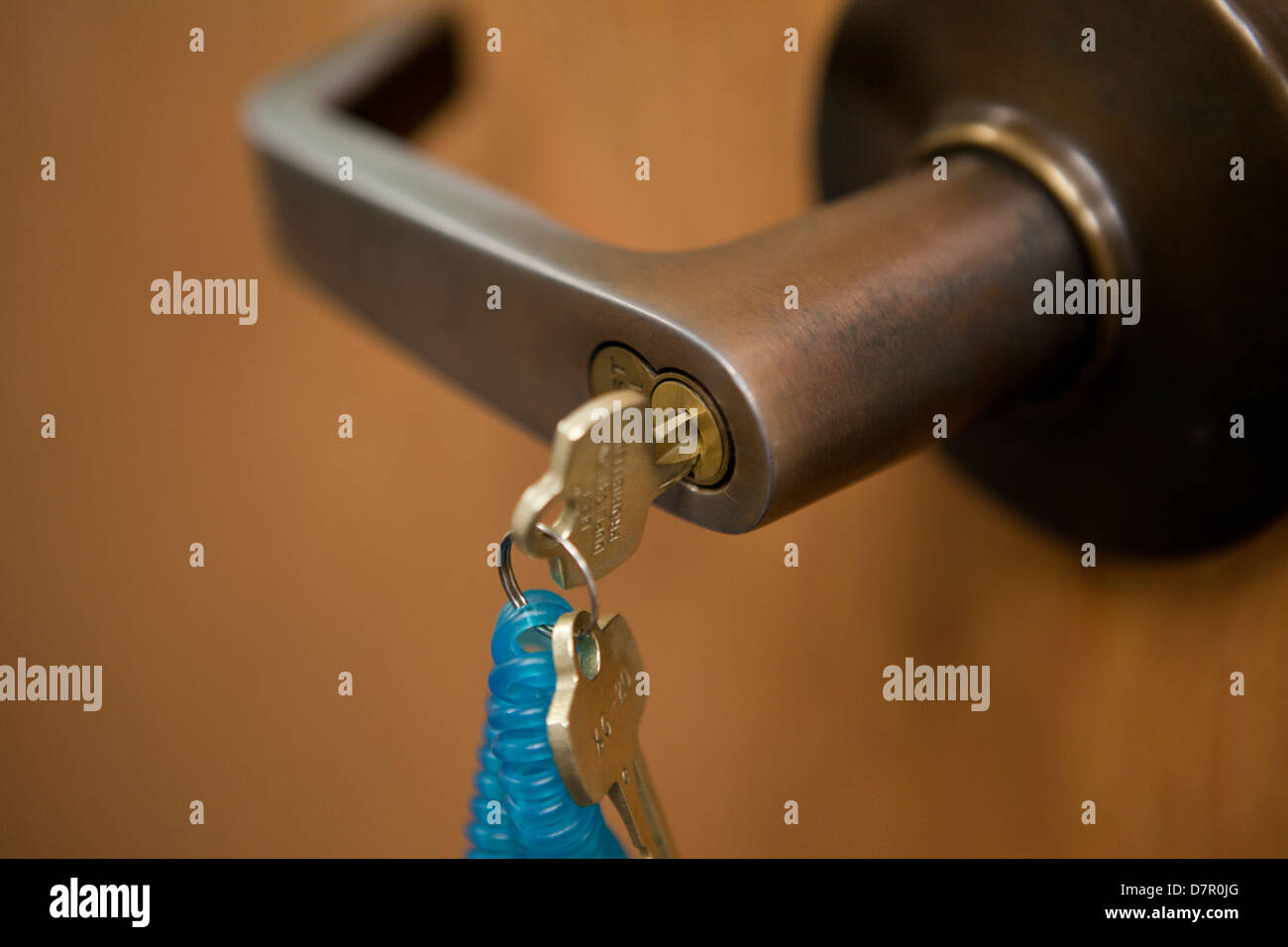 Key in office door lock - Stock Image