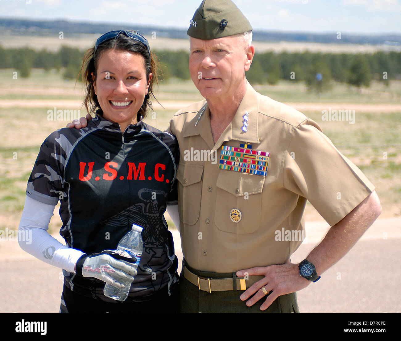May 12, 2013: Commandant of the Marine Corps, General James F. Amos, congratulates Marine wounded warrior cyclist, Stock Photo