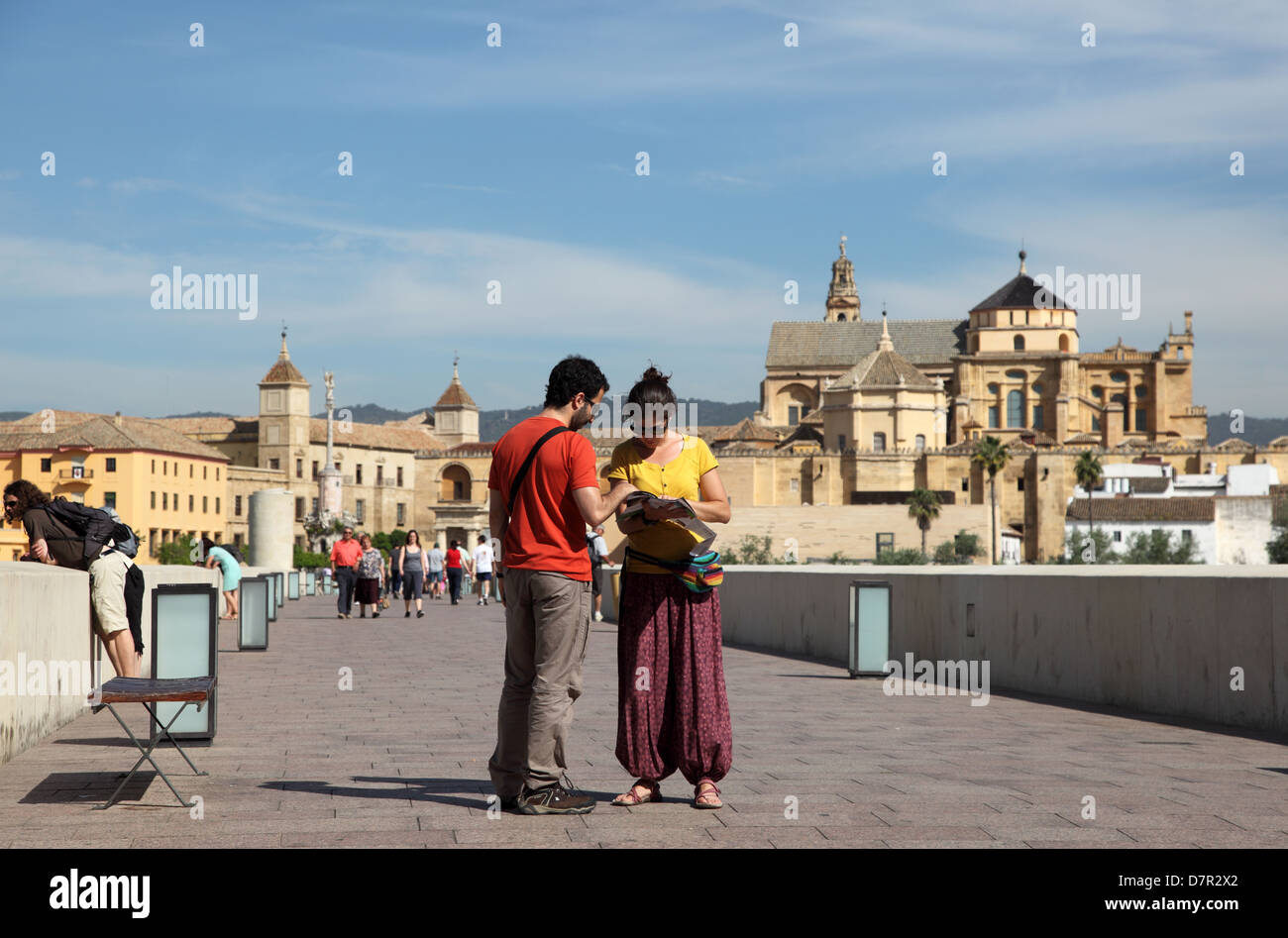 Tourists on the bridge in Cordoba, Andalusia Spain - Stock Image