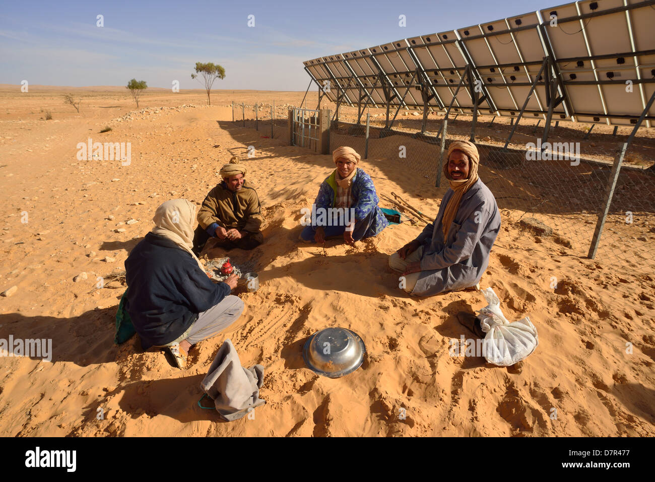 Solar Panels generating Electricity for a water pumpstation in the desert near Douz, South of Tunisia. - Stock Image