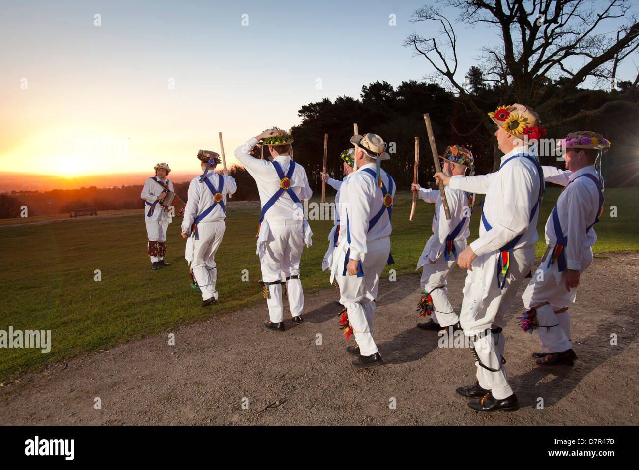 The Jockey Morris Men of Birmingham dance in the first sunrise on the first day of May at Lickey Hills Country Park, - Stock Image