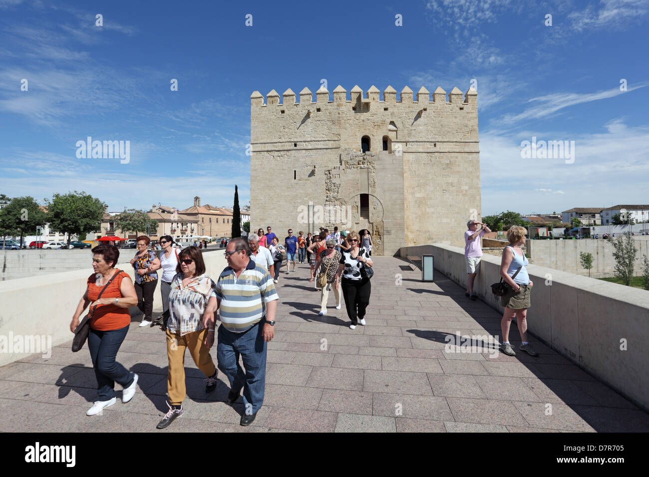 Tourists on the ancient bridge with tower - Torre de la Calahorra in background. Cordoba, Andalusia Spain - Stock Image