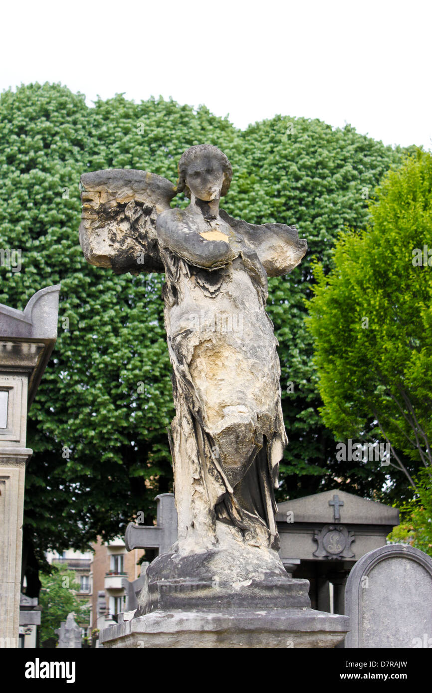 old angel tombstone on Pere Lachaise cemetery in Paris - Stock Image