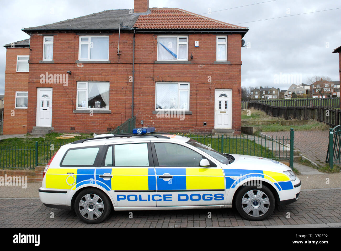 Police dog vehicle outside the home of Karen Matthews in Dewsbury, West Yorkshire. - Stock Image