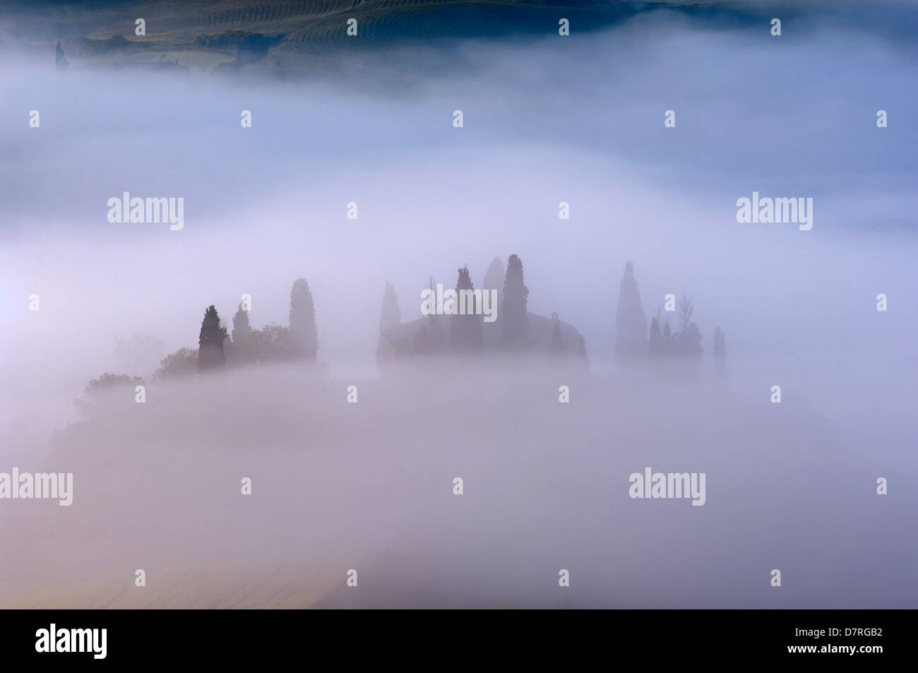 Val d'Orcia. Orcia Valley. Morning fog. The Belvedere at dawn.UNESCO World Heritage Site. San Quirico d'Orcia. - Stock Image