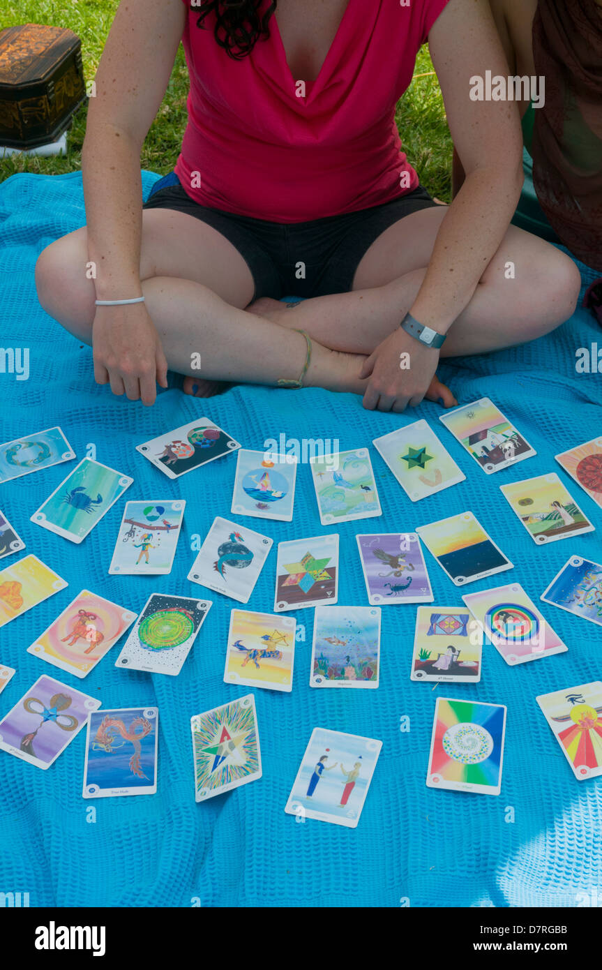 Young fortune teller with astrological cards on a blanket - Stock Image