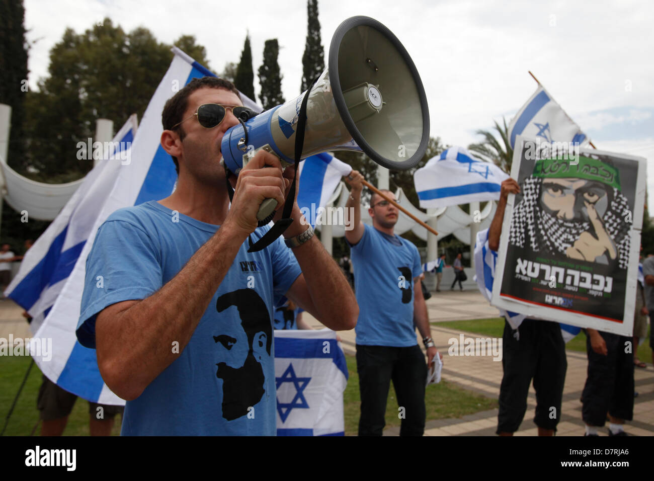Israeli Right wing activists shouting anti Palestinian slogans during a demonstration against a ceremony commemorating - Stock Image