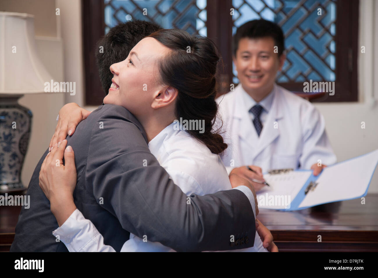Patient and Spouse Hug at the Good News - Stock Image