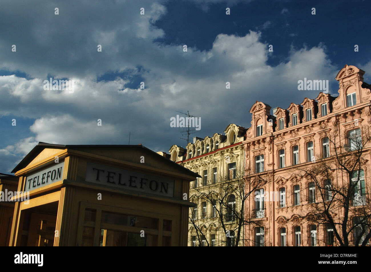 Old style telephone kiosk and classic houses in Karlovy Vary, Czech Republic, Europe - Stock Image