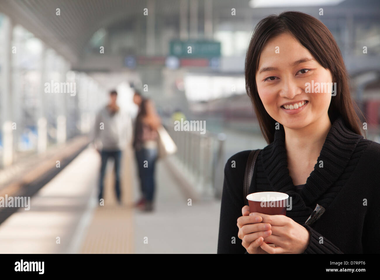 Young Woman on Train Platform - Stock Image