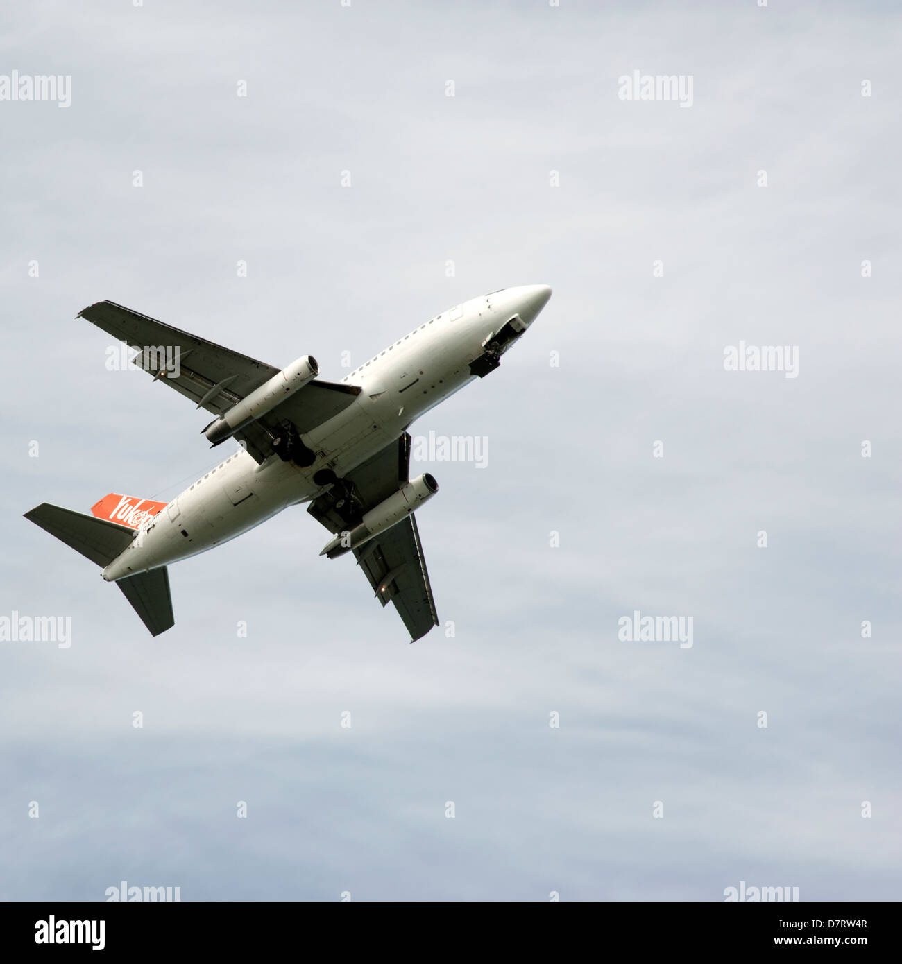 An airplane in the sky from Air North, Yukon, Canada airline - Stock Image