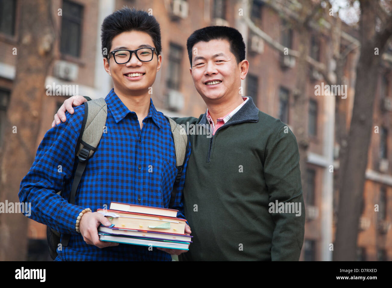 Father and son portrait in front of dormitory - Stock Image