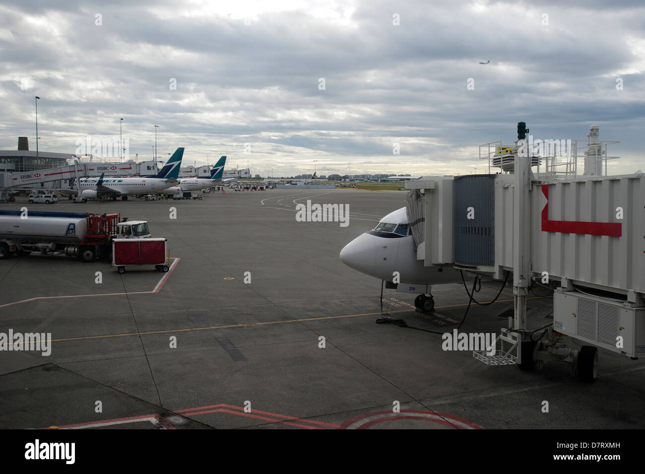 Airplanes on the tarmac at Vancouver International Airport, British Columbia, Canada - Stock Image