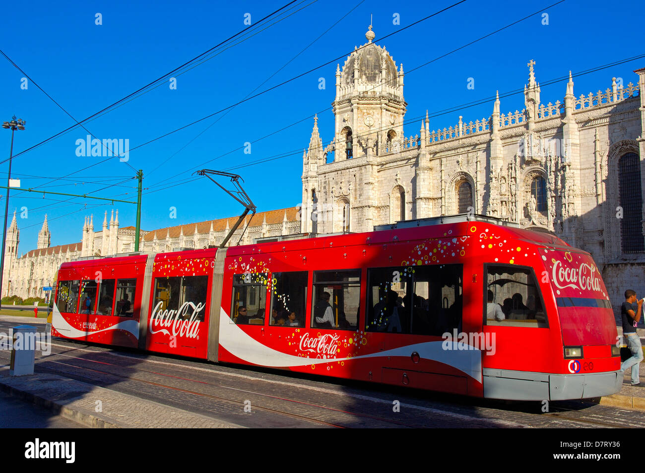 Local Tramway ´Electrico´ passing by the Monastery of the Hieronymites, Mosteiro dos Jeronimos. UNESCO World Heritage Stock Photo