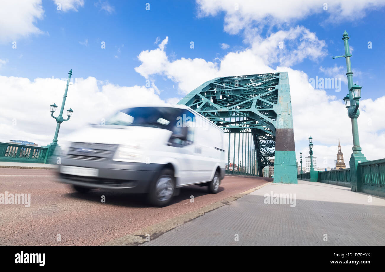 Busy traffic crossing the Tyne Bridge at Newcastle Upon Tyne. - Stock Image