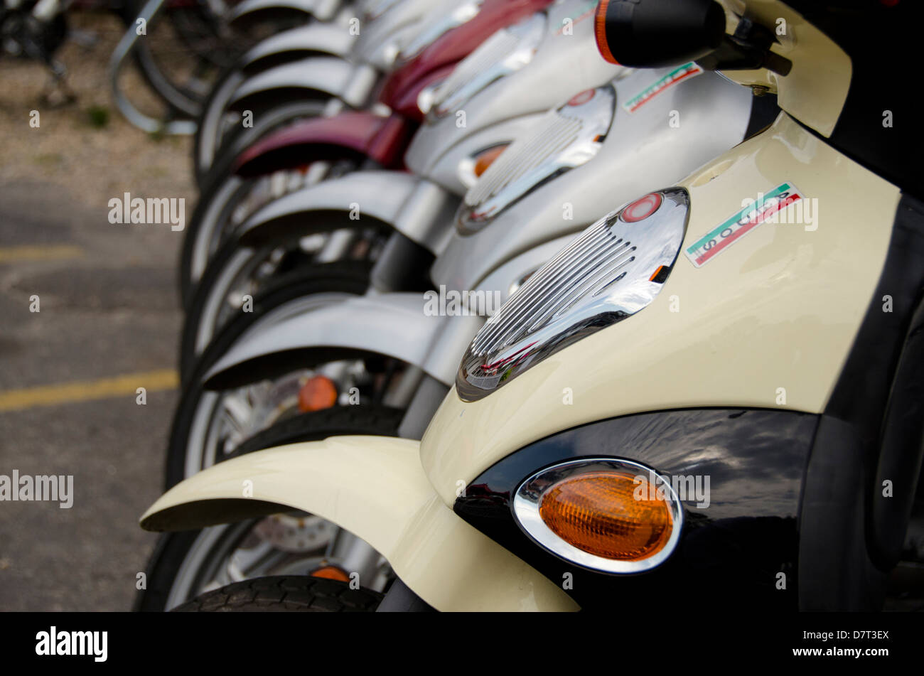 Rhode Island, Block Island. Motor scooters lined up ready for rental. - Stock Image