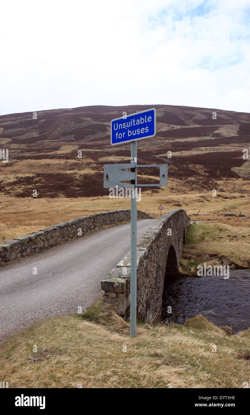 Bridge off the A93 on the Old Military Road in the highlands of Scotland with a sign stating unsuitable for buses - Stock Image