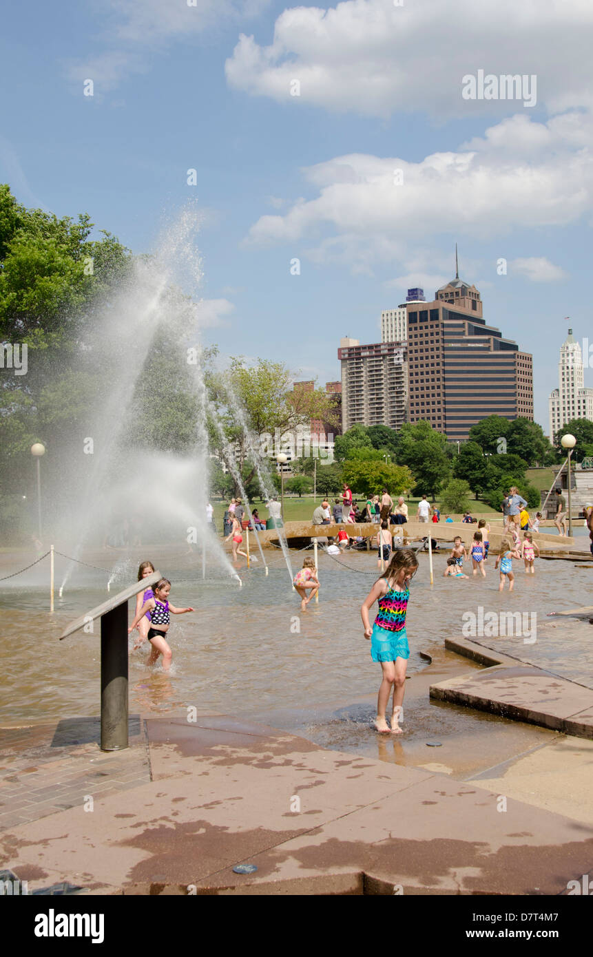 Tennessee, Memphis. Mud Island River Park. Children playing in the water fountain on a hot summer day. - Stock Image