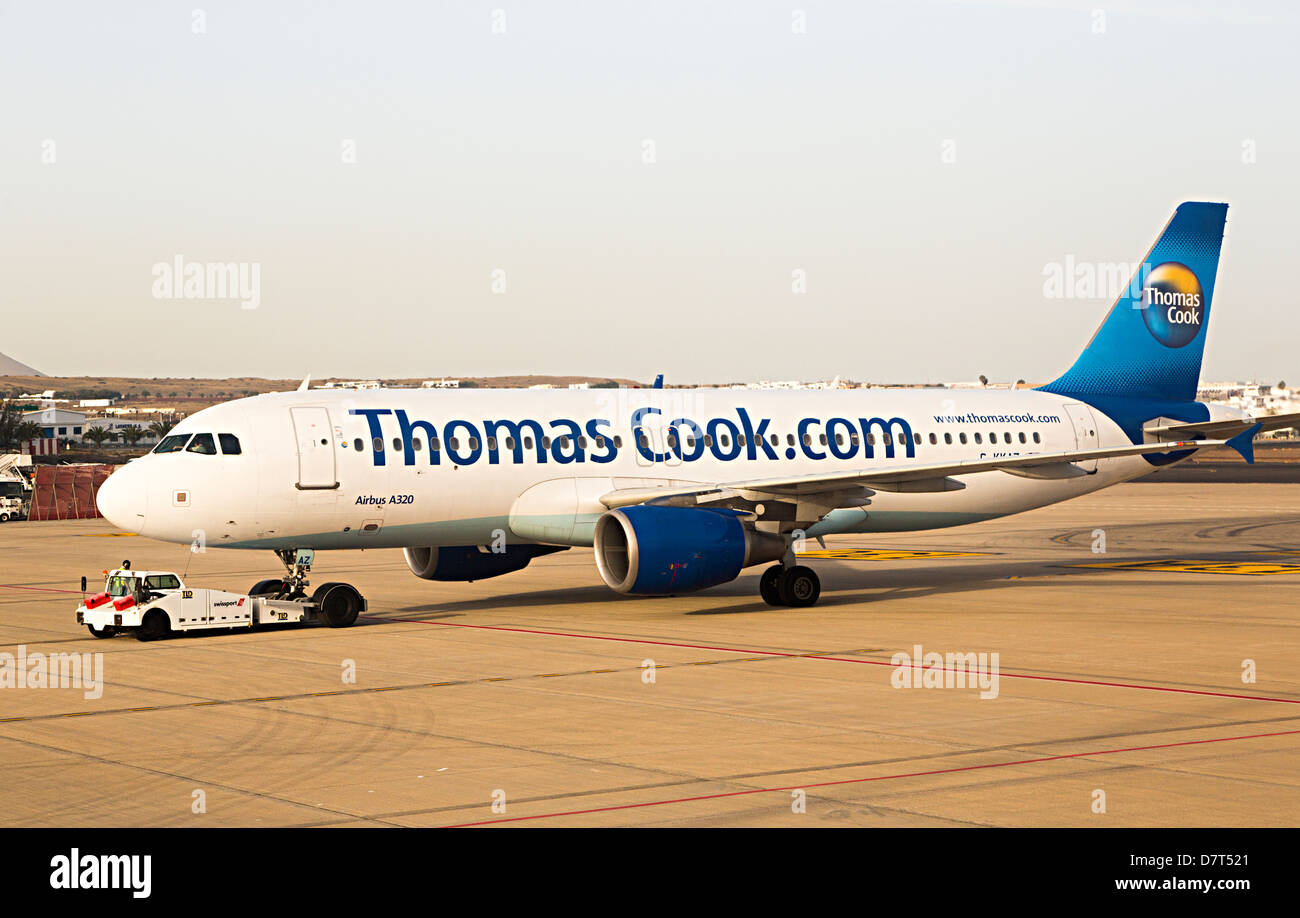 Thomas Cook aircraft Airbus A320 on runway, Lanzarote, Canary Islands, Spain - Stock Image