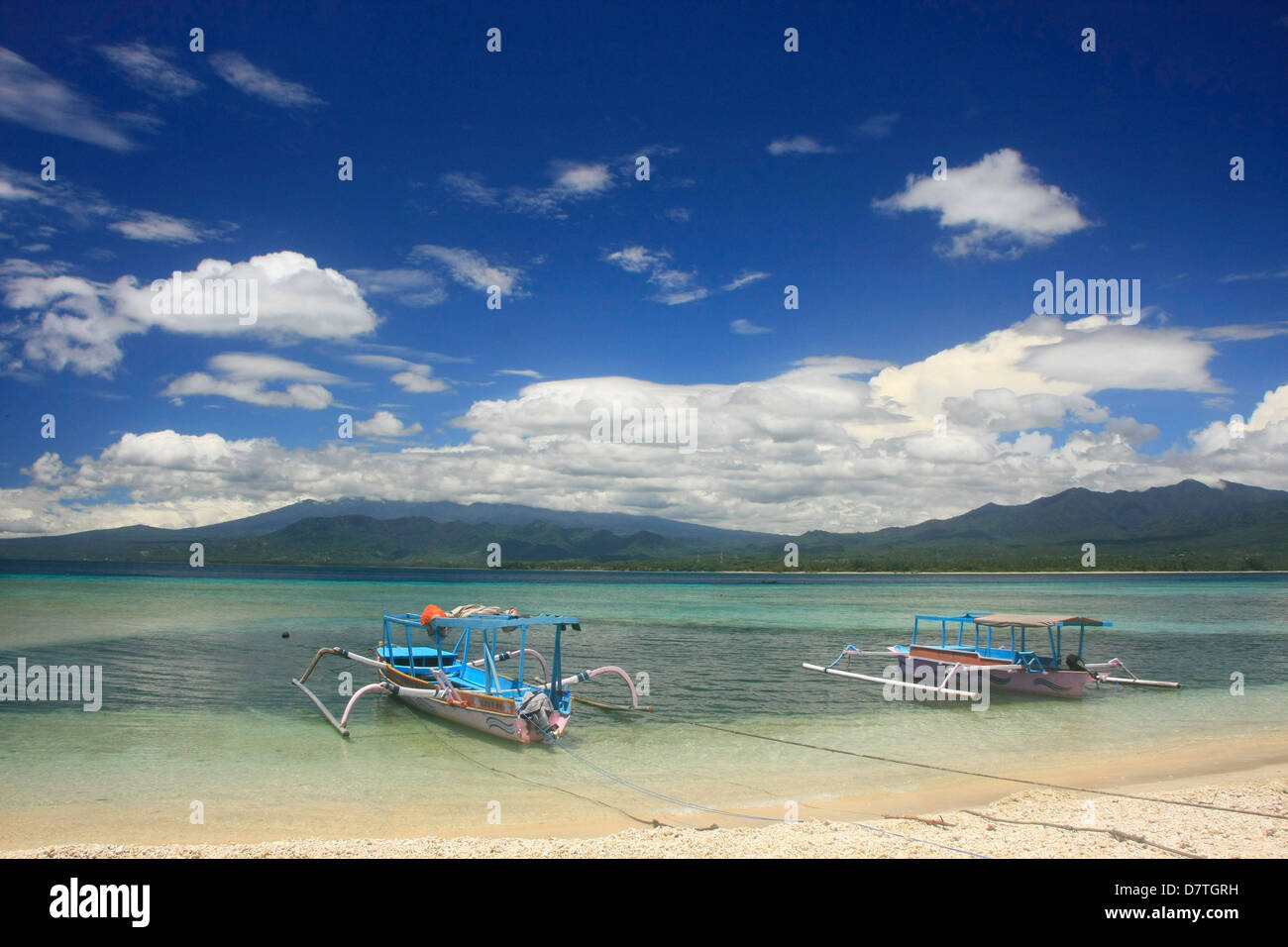 Outrigger boats at beach, Gili Air island, Indonesia - Stock Image