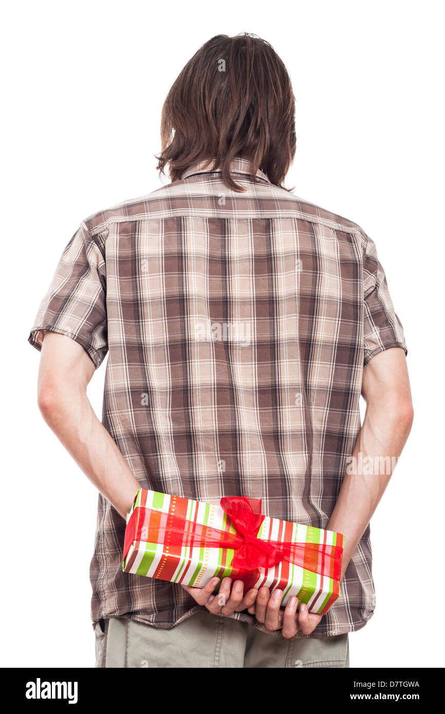 8bd29a91982 Rear view of a man holding small gift box, isolated on white background -  Stock
