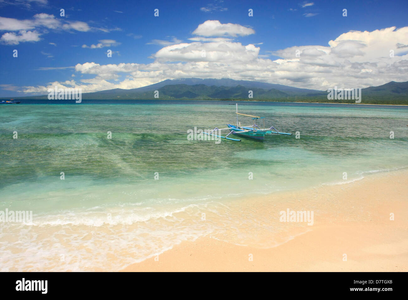 Outrigger boat at beach, Gili Air island, Indonesia - Stock Image