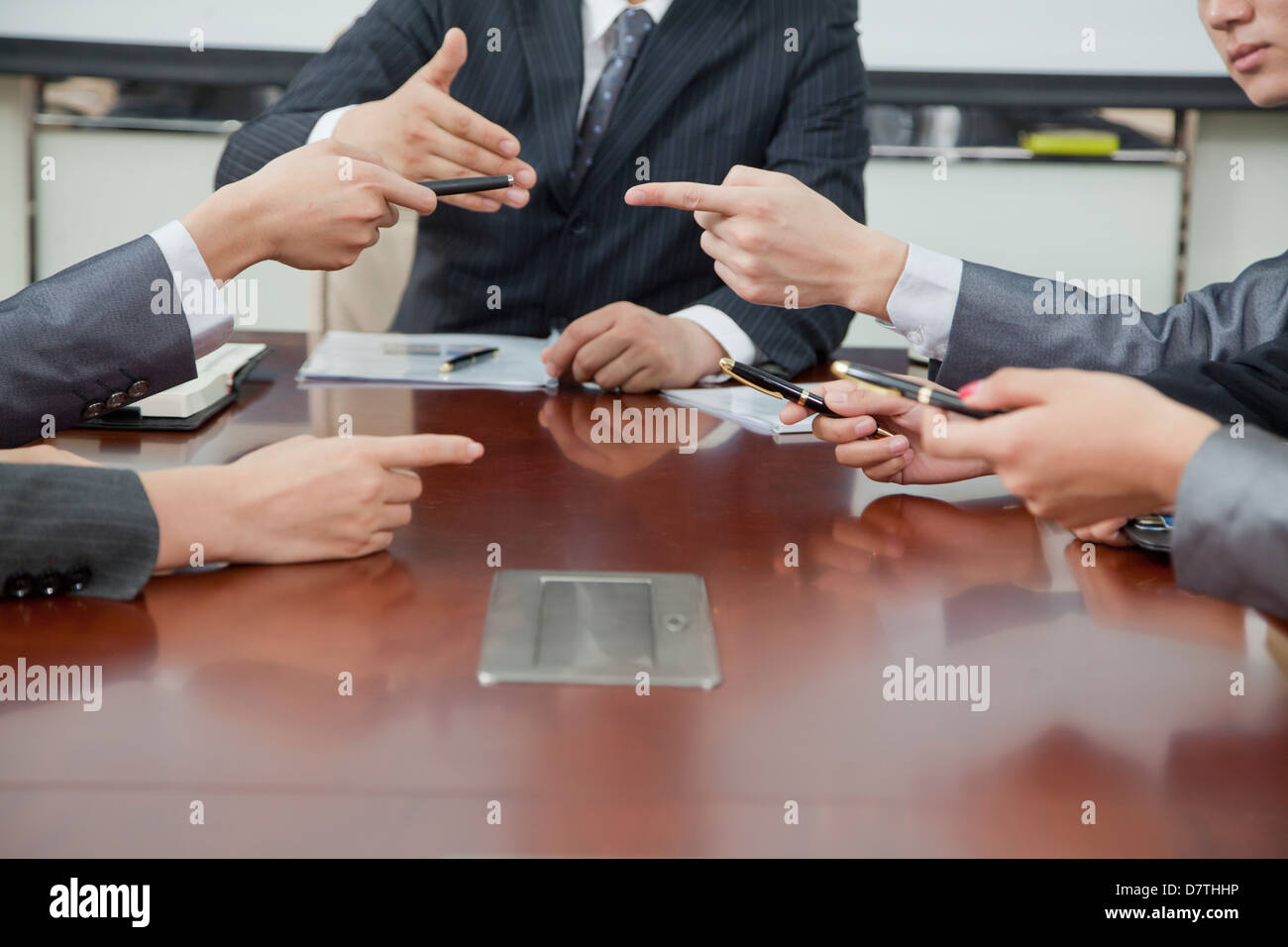 Businesspeople Making Gestures During Business Meeting Stock Photo