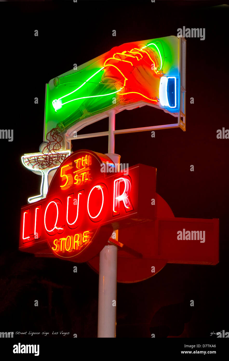 A high quality night shot of the 5th street liquor store sign - Stock Image