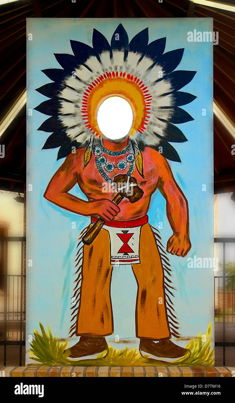 A Navajo Chief photo mural with a head cutout for vacation photos. On Business Route 66,Holbrook Arizona. - Stock Image