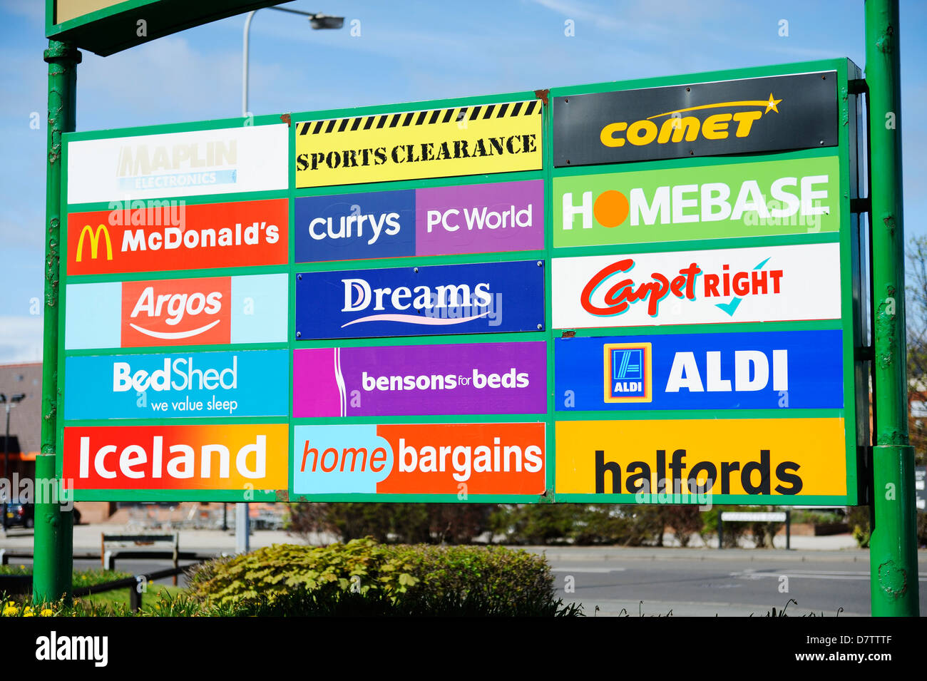 Store logos and signs advertising their presence in a shopping complex in Llandudno. - Stock Image