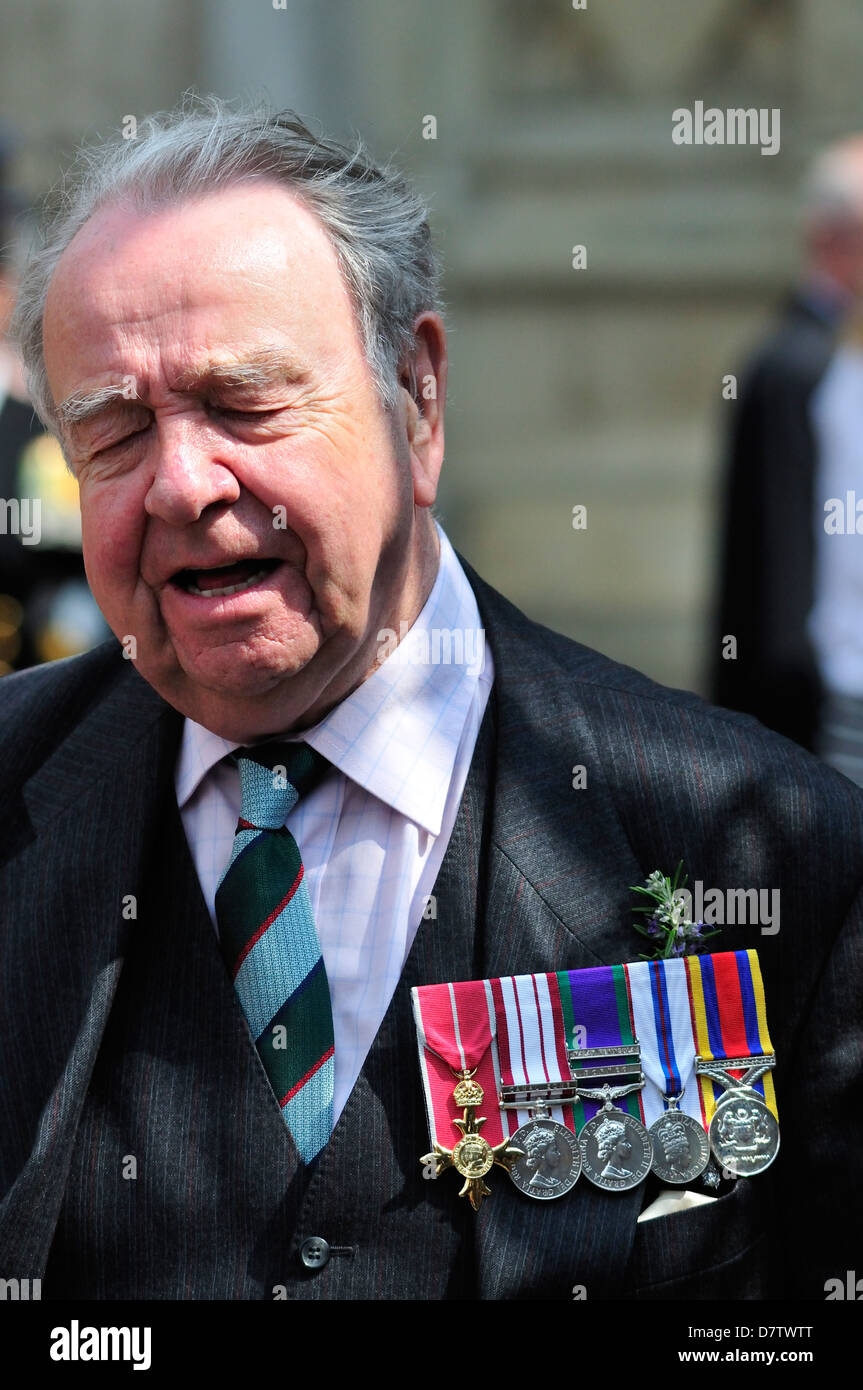 Anzac Day, London, 25th April 2013. Service at Westminster Abbey. Retired soldier with medals, including OBE - Stock Image